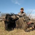 paul-atkins-and-wildebeest